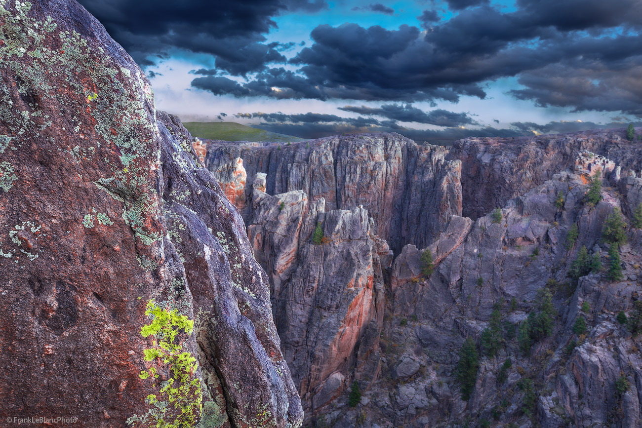 Peering into the depths of Black Canyon reveals a never ending view of impregnable towers and rock fortresses. A left fore-ground...